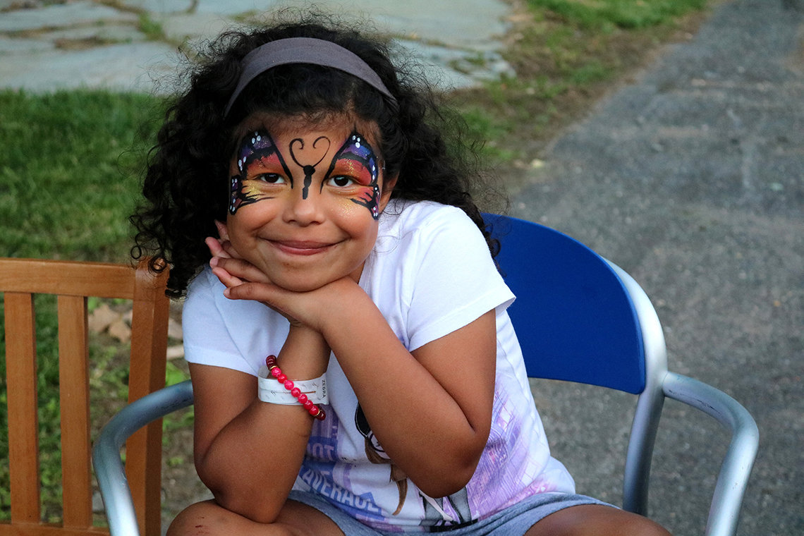 Emma Sotelo of Texas shows off her butterfly face paint.
