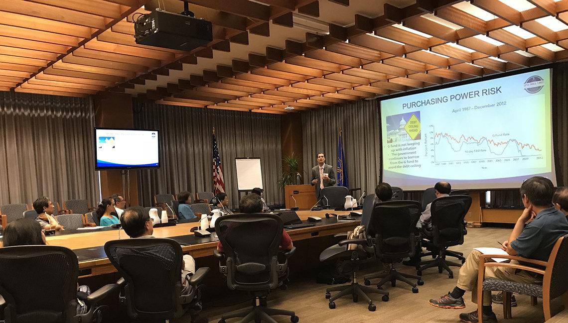 NIH employees listen to a presentation