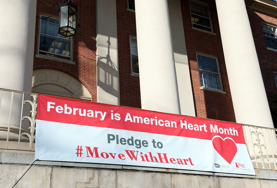 Banner hanging in front of Bldg. 1 reads: Pledge to Move with Heart