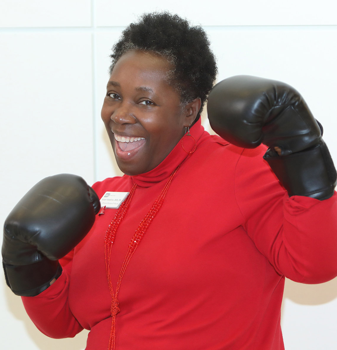 Clinical Center nurse poses in boxing gloves