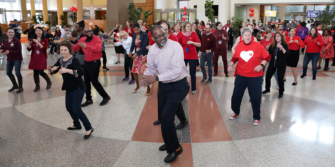 NHLBI dir Dr. Gibbons leads line dance at Clinical Center