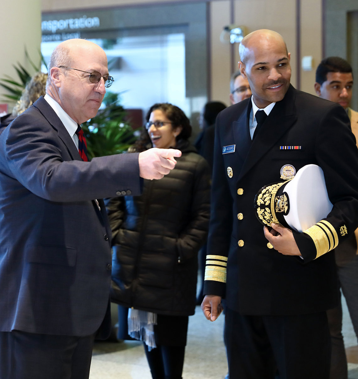 Dr. Gilman chats with U.S. surgeon general Dr. Adams in Clinical Center lobby