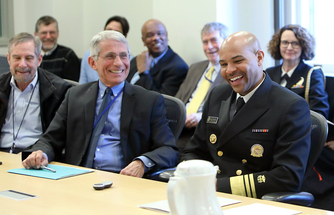 Dr. Fauci and the new surgeon general share a laugh before the briefing