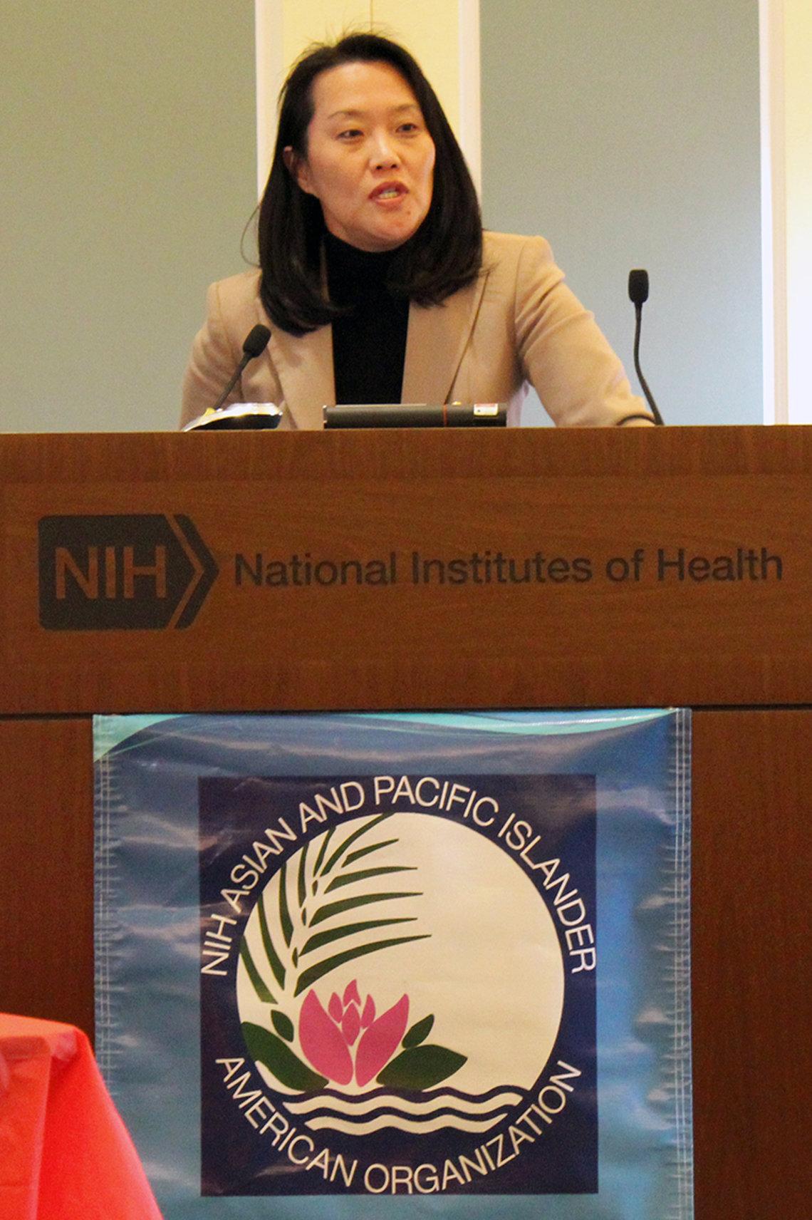 Keynote speaker Dr. Janice Lee at podium