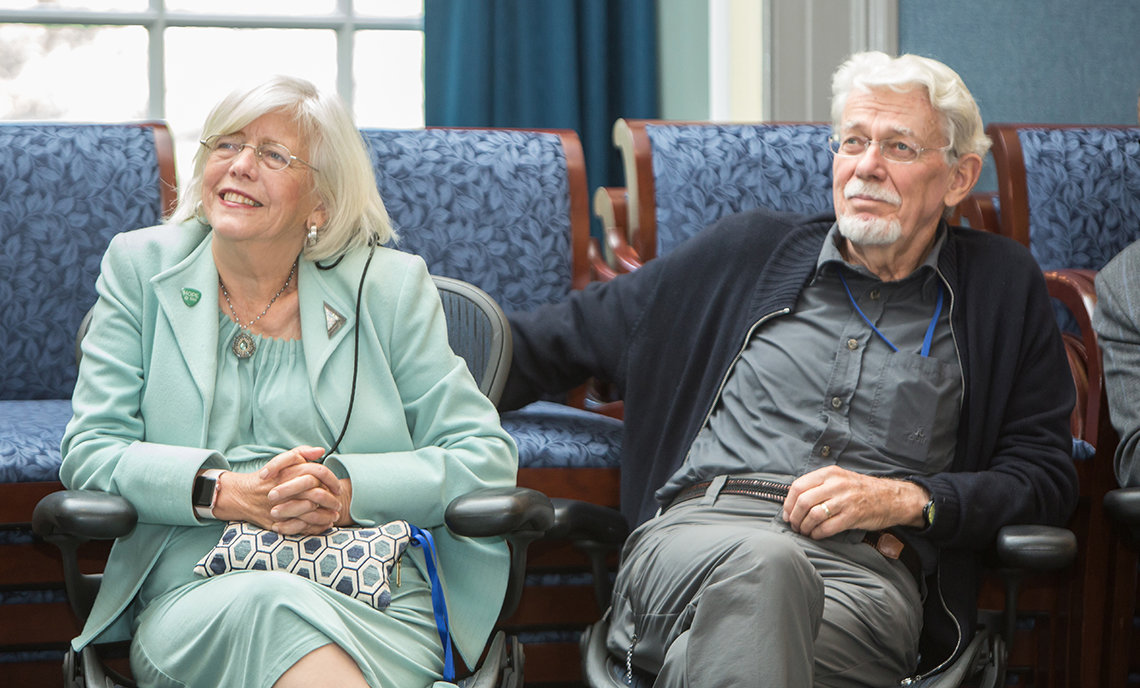 Dr. Briggs sitting with her husband