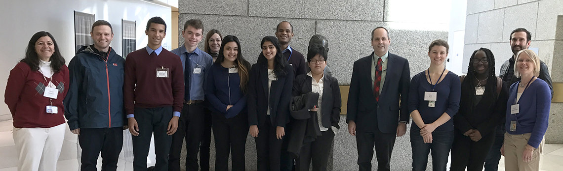 group photo of students with NIH staffers