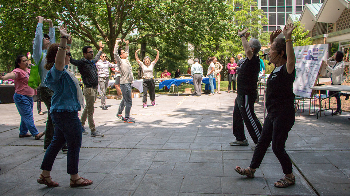 Instructors Hoang-Tam Hilton and Thomas Huppmann teach tai chi basics.
