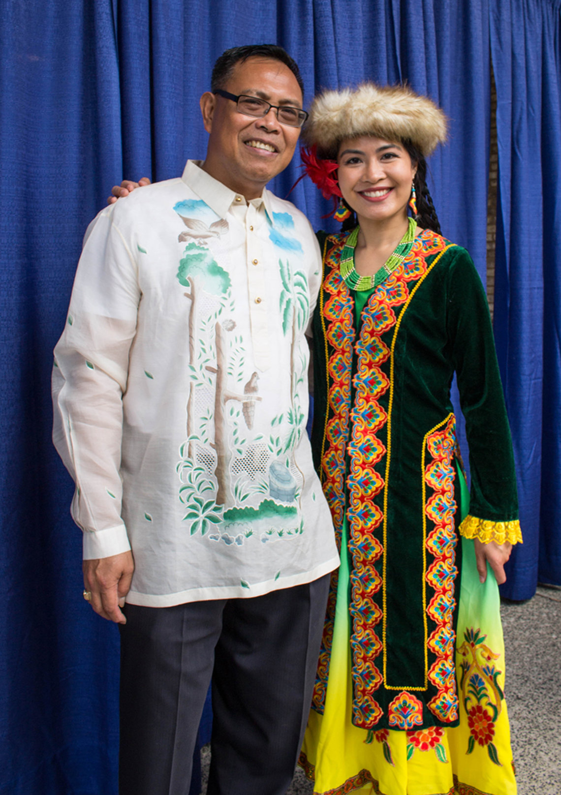 Edgar Esmaba rocks the Filipino barong with Karen David in Uighur traditional dress and hat.