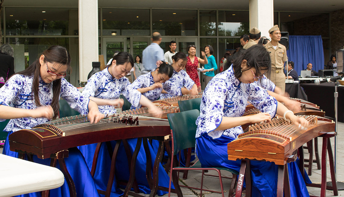 The Guzheng ensemble with NIH staffer Ziyi Liu