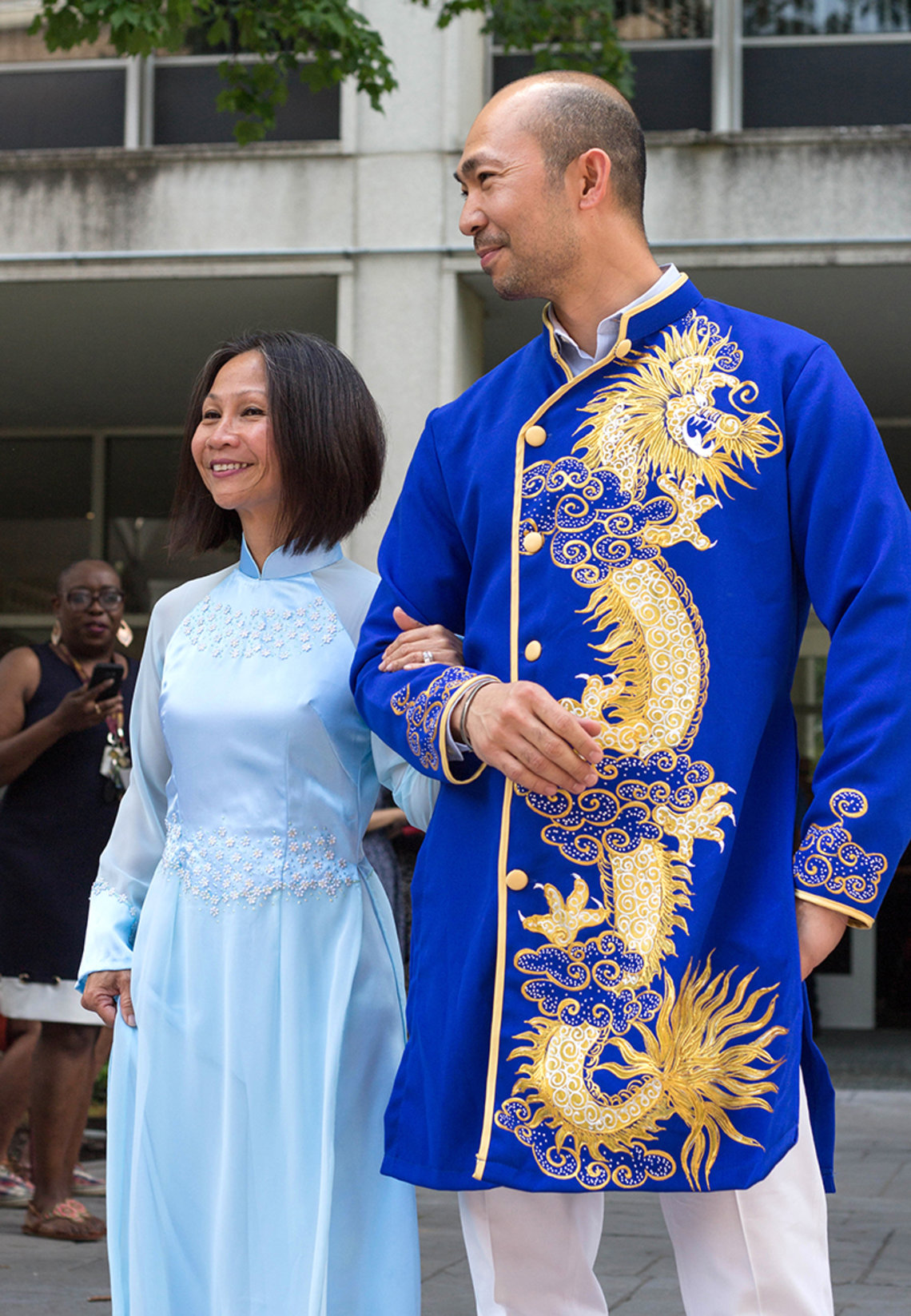 Lonnie Lisle and Jimmy Do wear the Vietnamese ao dai.