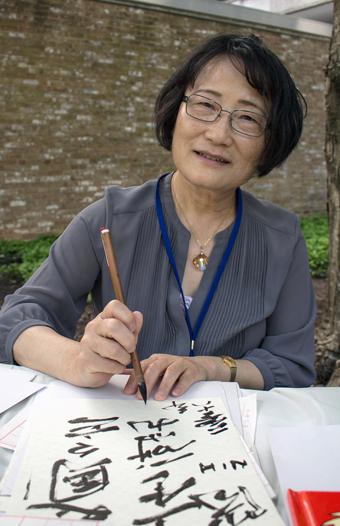 "Hui Chen writes ""NIH"" in Chinese characters."