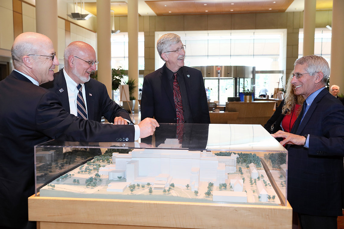 Redfield views the CRC model with Dr. James Gilman, Collins and Fauci.