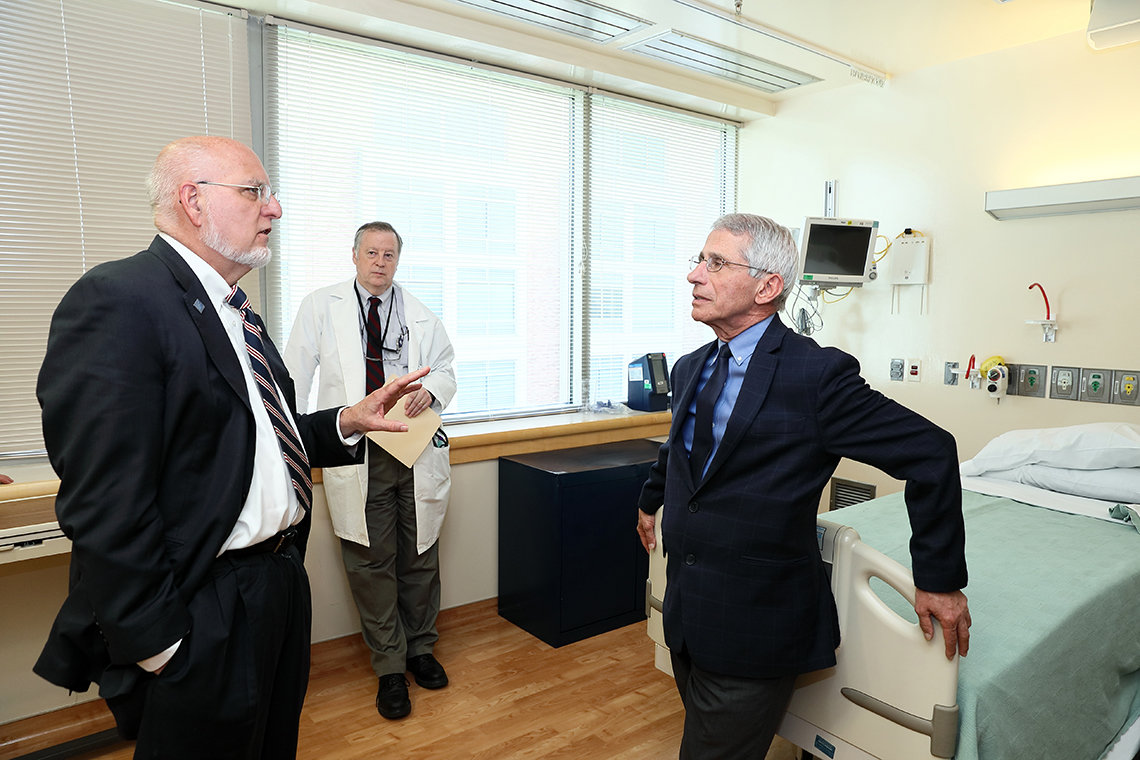 Redfield tours the special clinical studies unit with Fauci and Dr. Richard Davey.