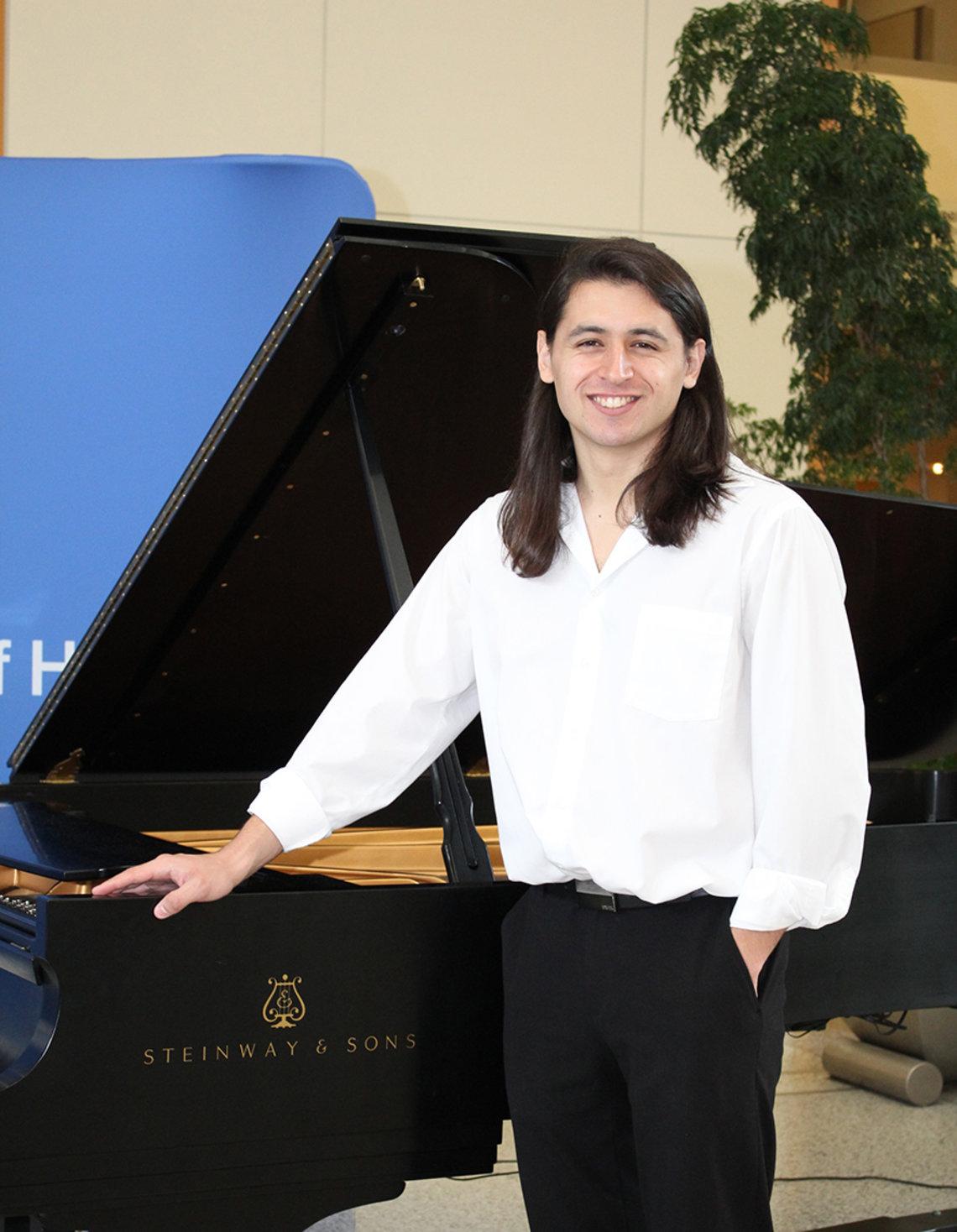 Local pianist, composer and singer Chris Urquiaga.