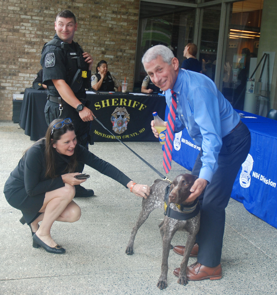 Peter Girgenti of Montgomery County Park Police, with Xena and Dr. Anthony Fauci.
