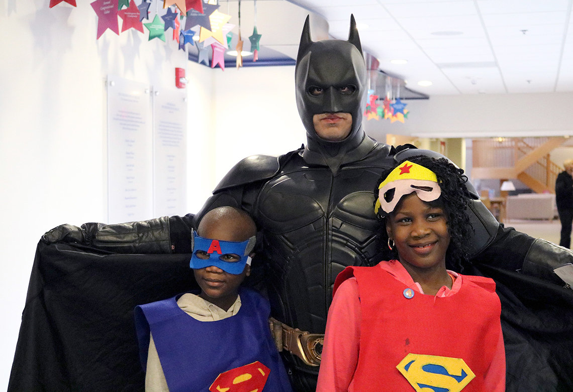 Manuel and Christina Adedeji pose with Batman.
