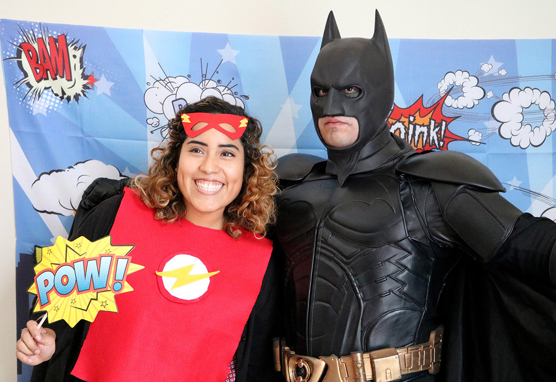 Lidia Rosas smiles with Batman.