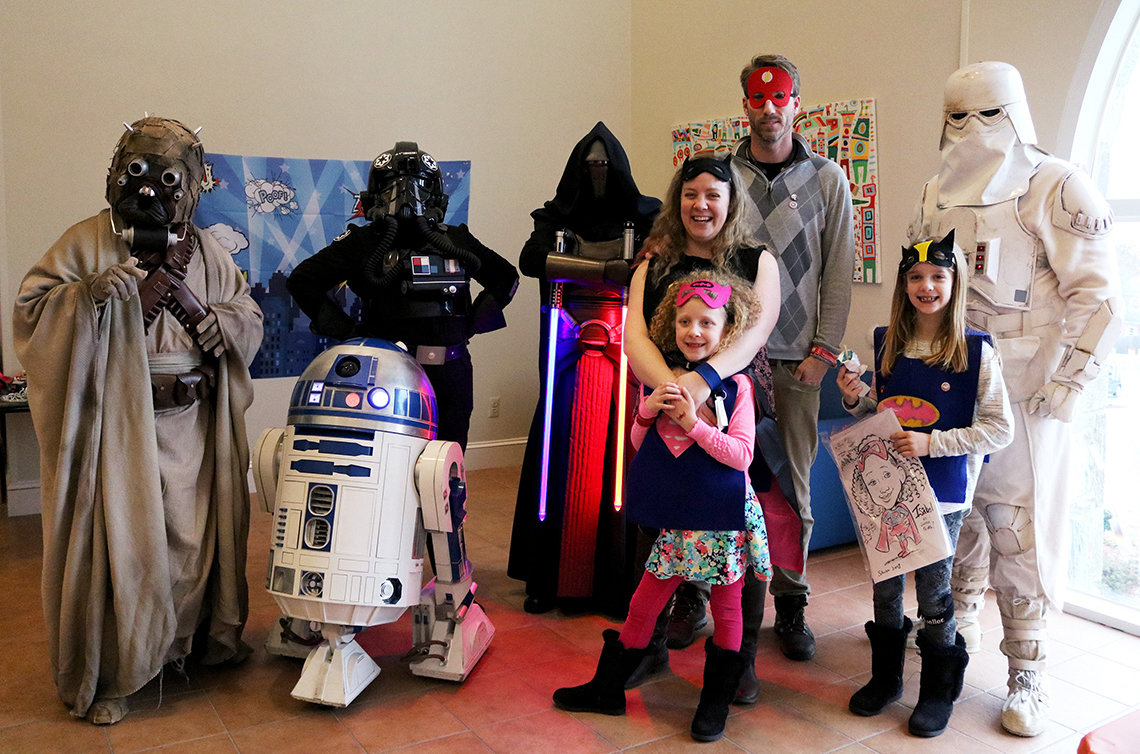 Members of the 501st Legion with Isabel and Lina Kerr and their parents Tara and Gordon.