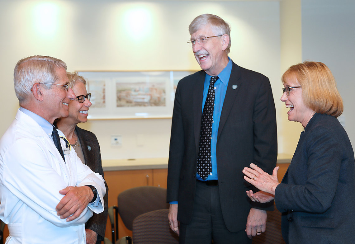 Hassan enjoys a laugh with Fauci, Bianchi and Collins.
