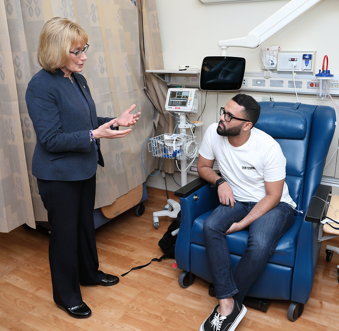 Hassan talks with a patient in NCI's Pediatric Oncology Branch.