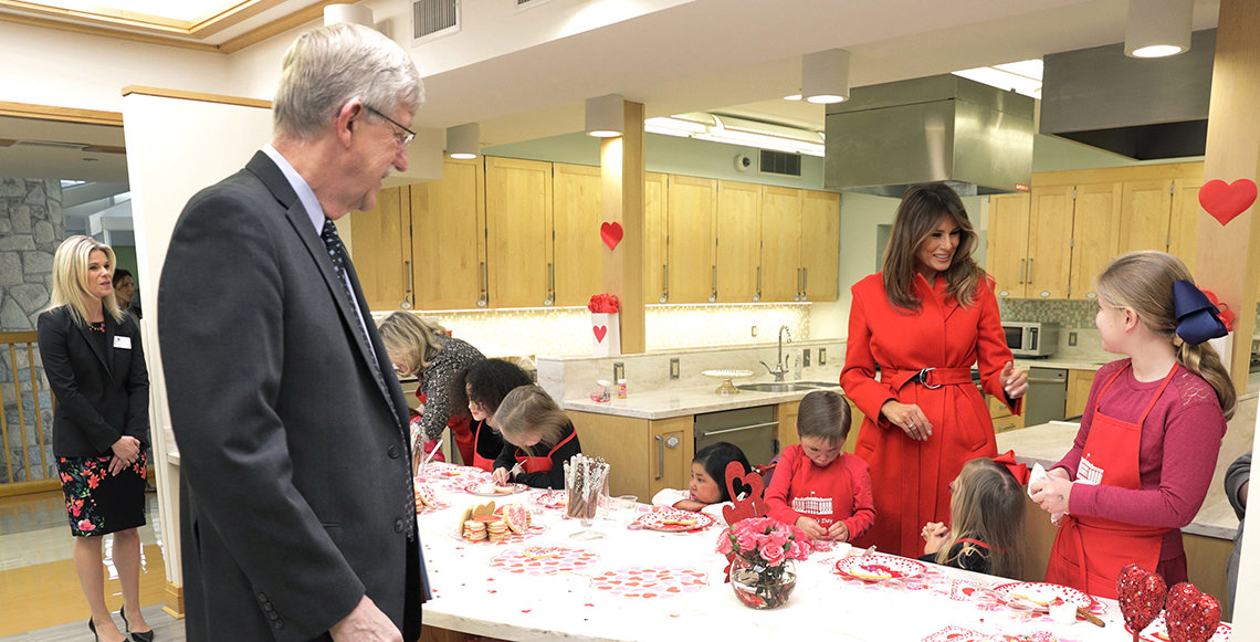 Melania Trump chats with Caitlyn Ribas, with Jennie Lucca and Dr. Francis Collins looking on.