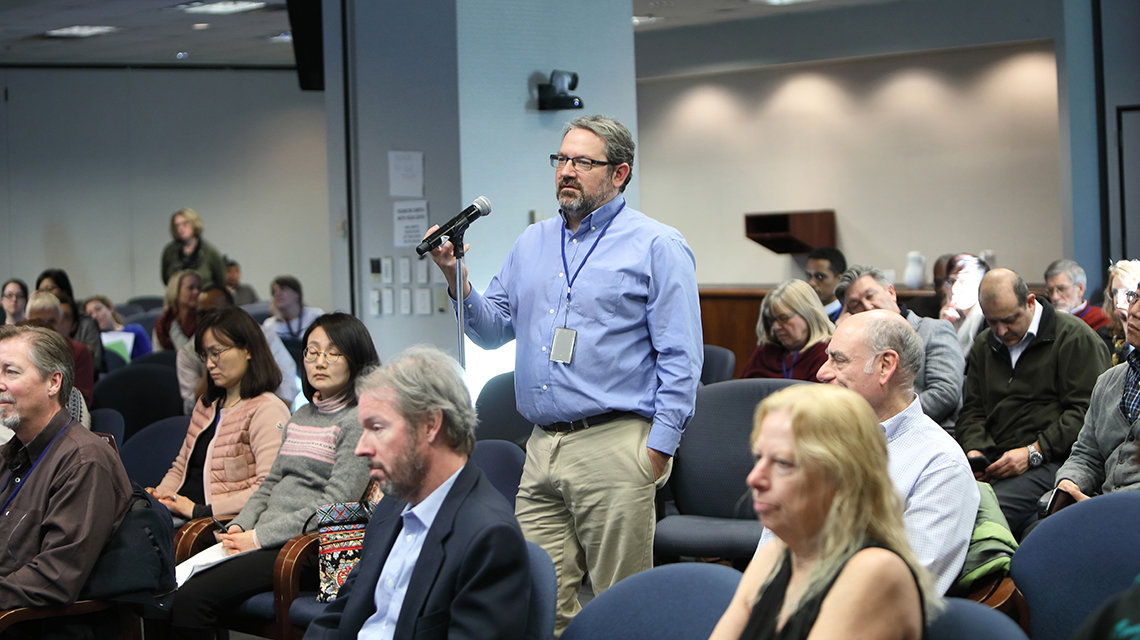 NIMH director Dr. Josh Gordon asks a question following Snyder's talk.