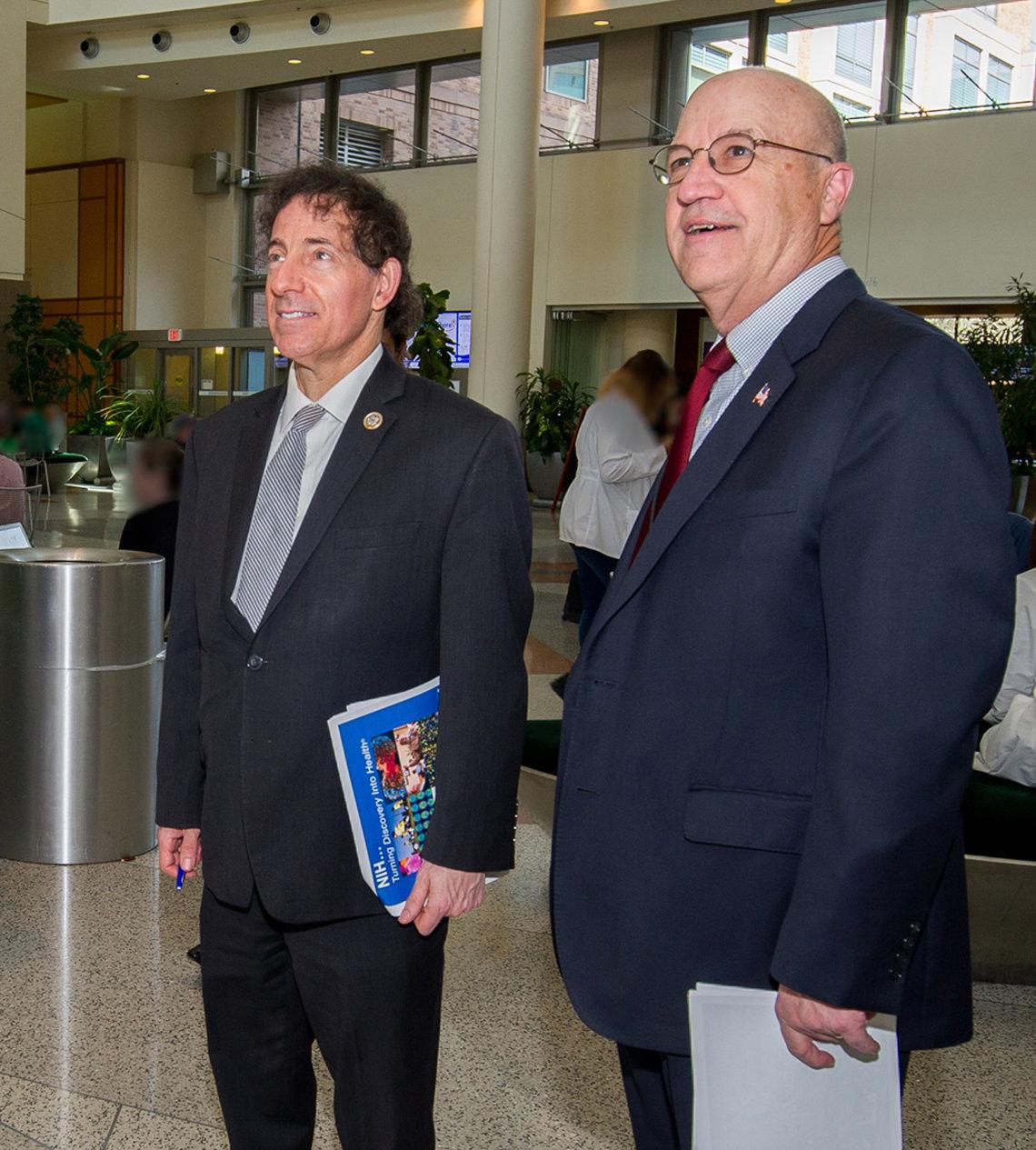 Raskin takes in the hospital atrium with Dr. James Gilman.