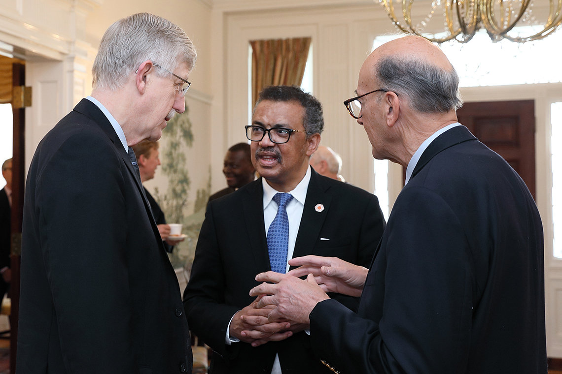 Tedros chats with Dr. Francis Collins and Dr. Roger Glass.