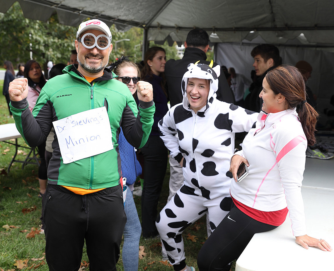 NEI staff dressed in minion and cow costumes goofing off under the tent