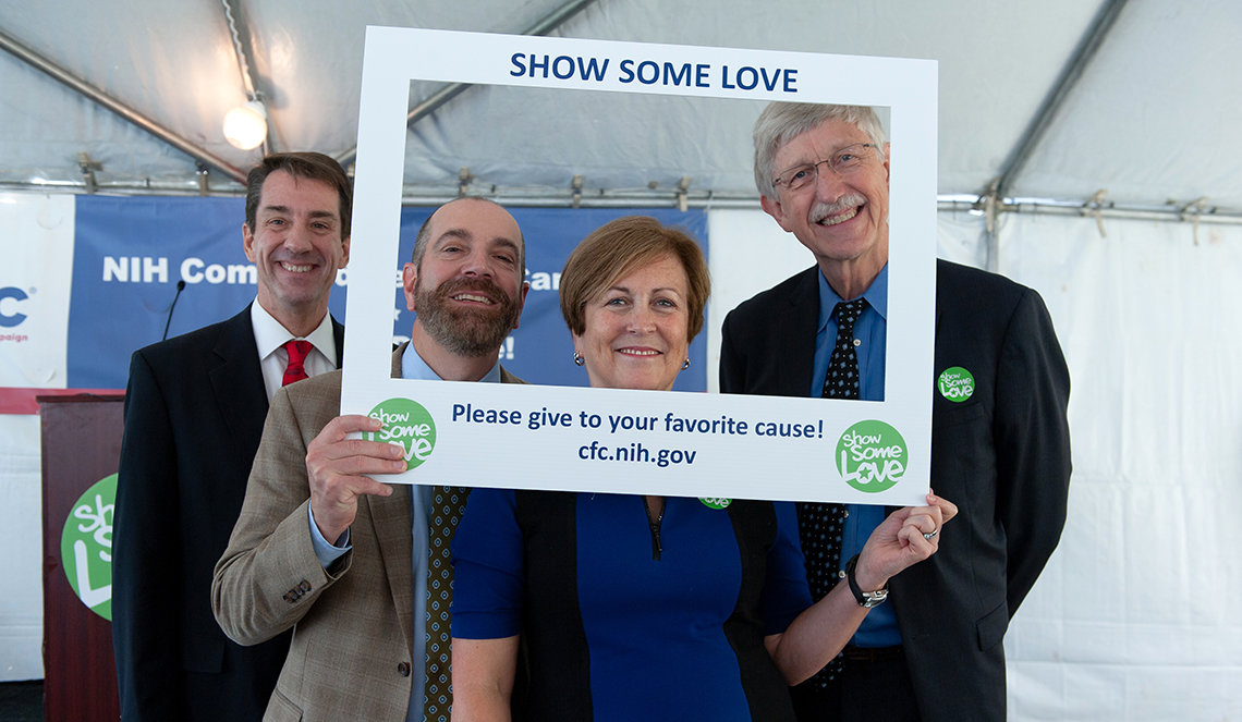 Dr. Christopher Austin, Keith Lamirande, Deborah Rutter and Dr. Francis Collins pose for a photo