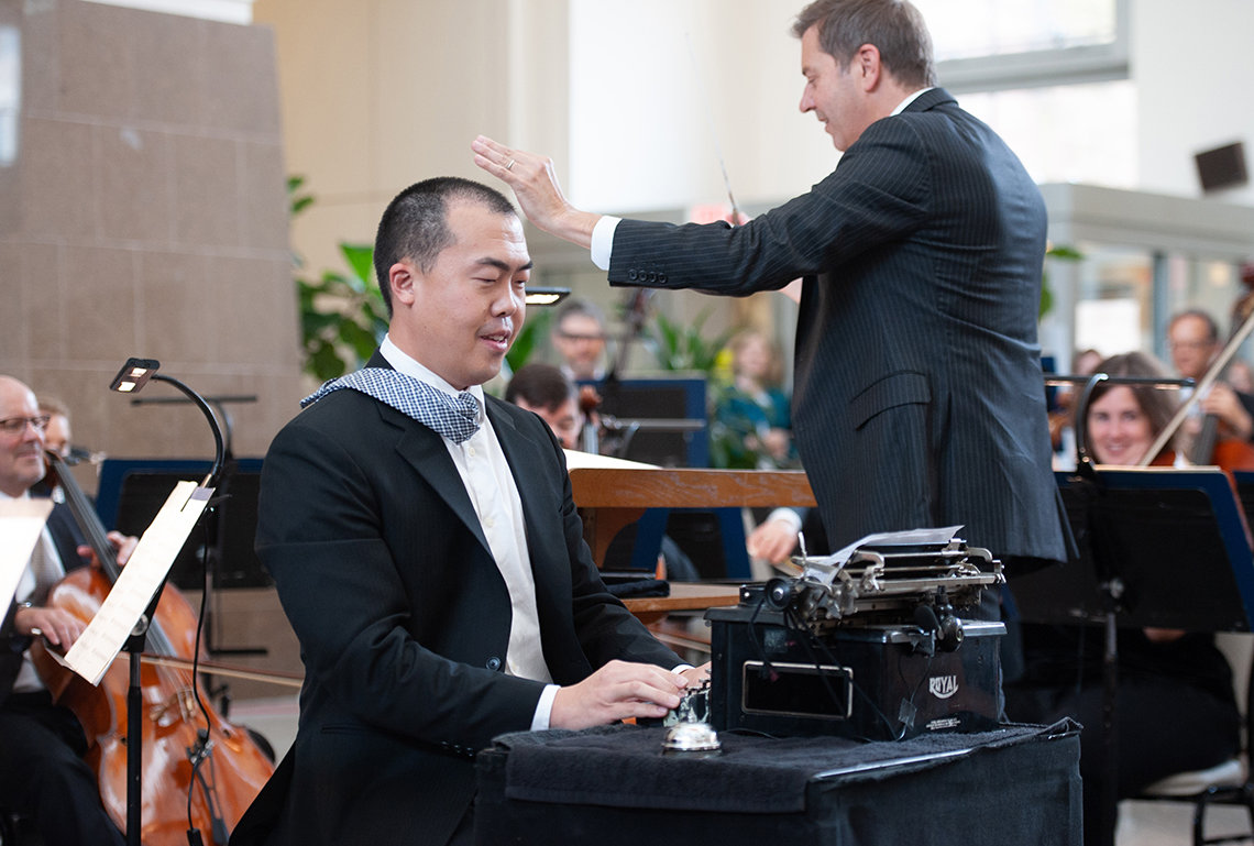 Eric Shin solos on typewriter as Steven Reineke leads the orchestra.