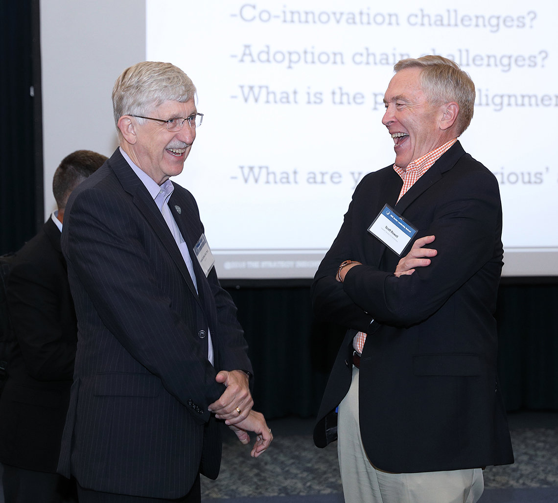 Dr. Francis Collins shares a light moment with Scott Rowell.