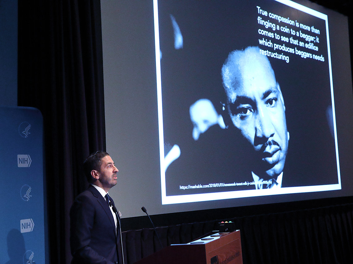 Galea stands next to a slide featuring a photo of Martin Luther King Jr.