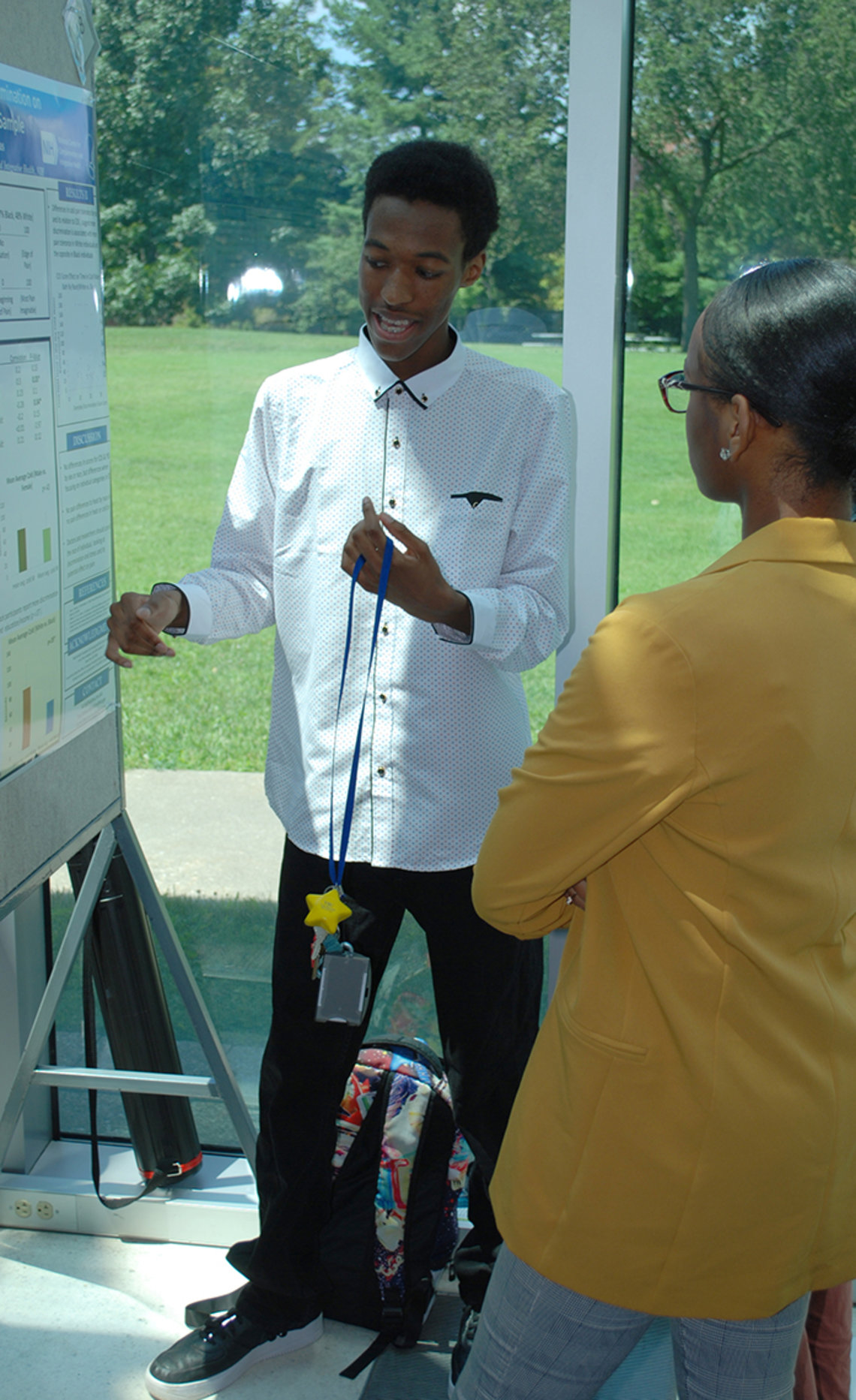 Students look at science poster