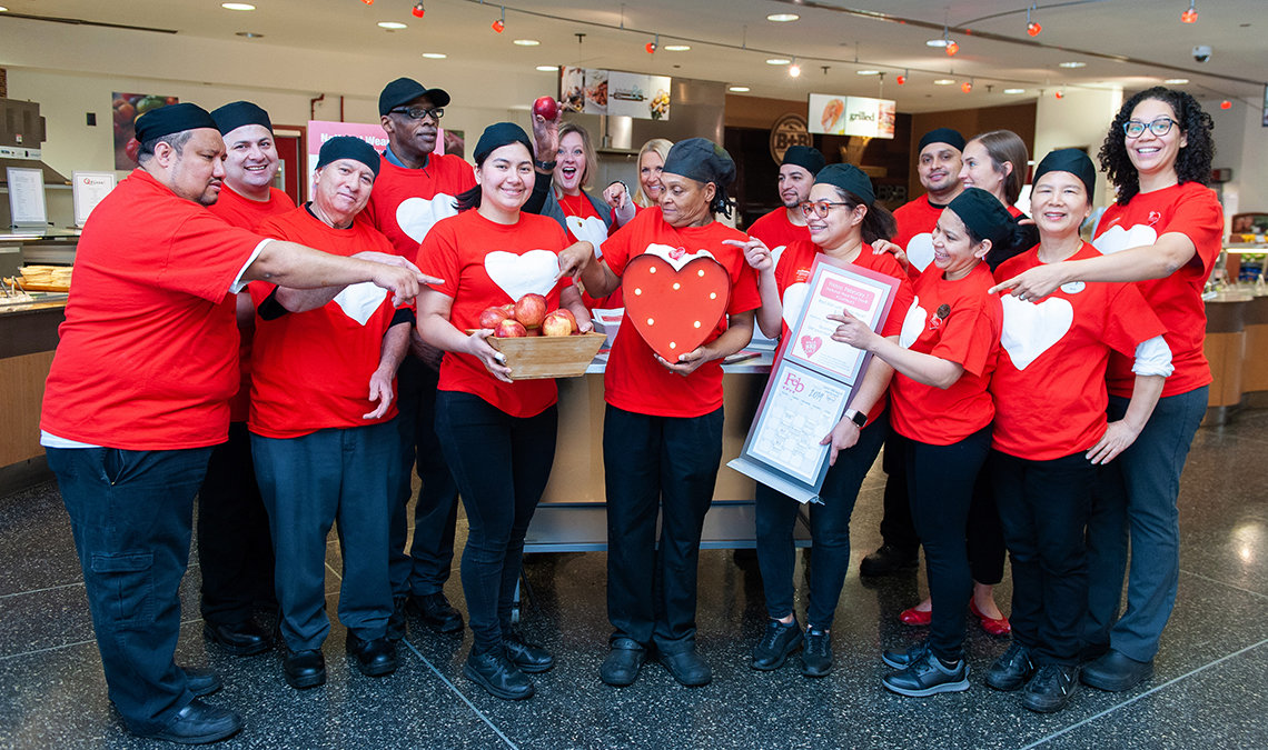 The Bldg. 31 cafeteria staff is all smiles, wearing red shirts with heart.