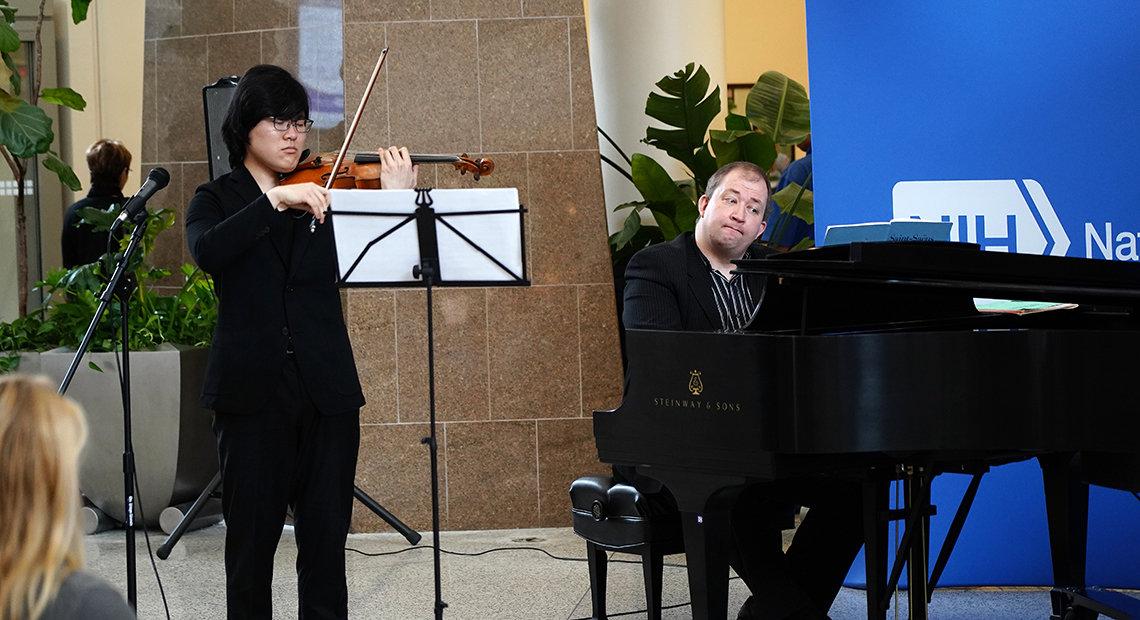 Naito and  Morozov play music in the hospital atrium