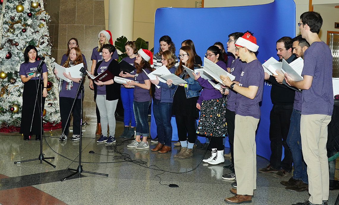 Singers perform for the holidays at the Clinical Center.