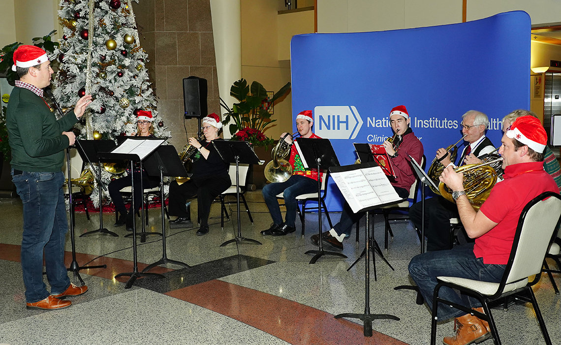 NSO horn ensemble performs at holiday party.