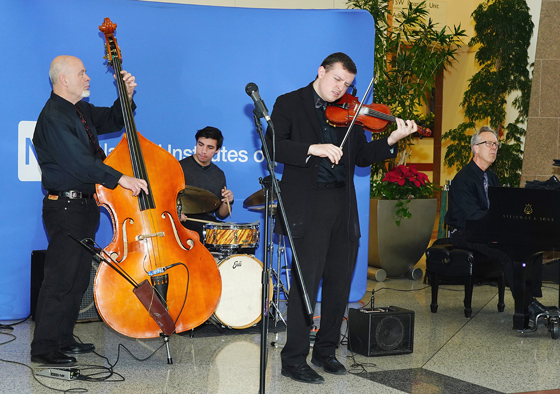 Jazz musicians play at holiday party