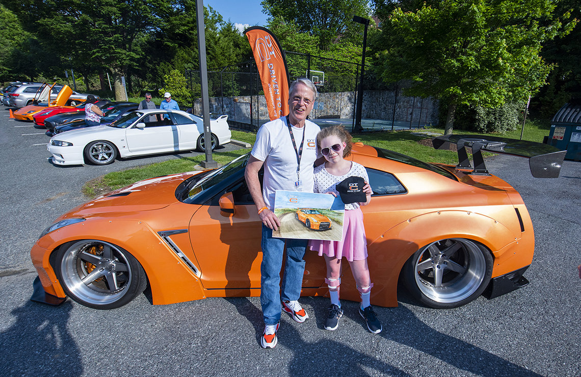 Lee and Jenna in front of Nissan GTR sportscar