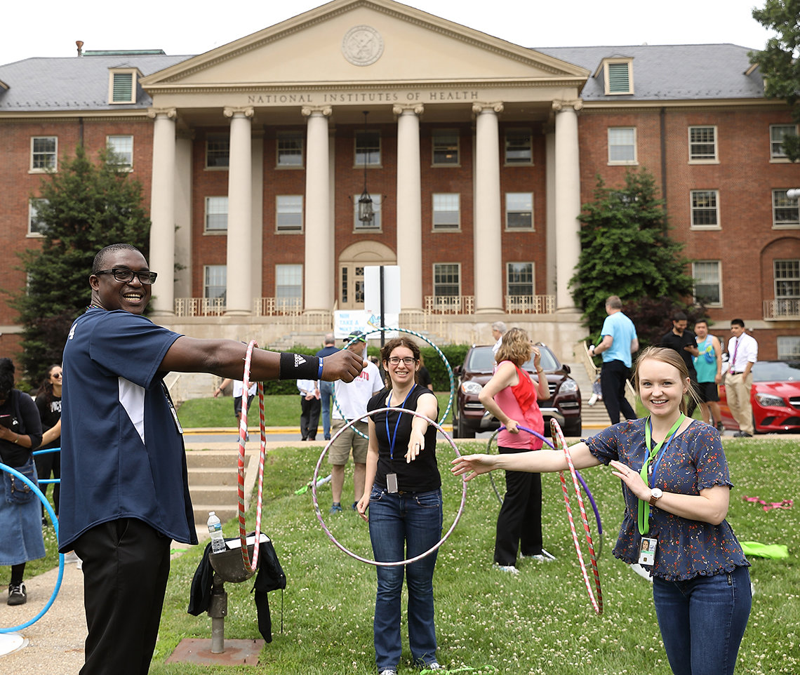 Participants hula hoop on the lawn