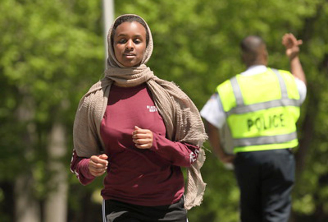 Woman wearing hijab runs