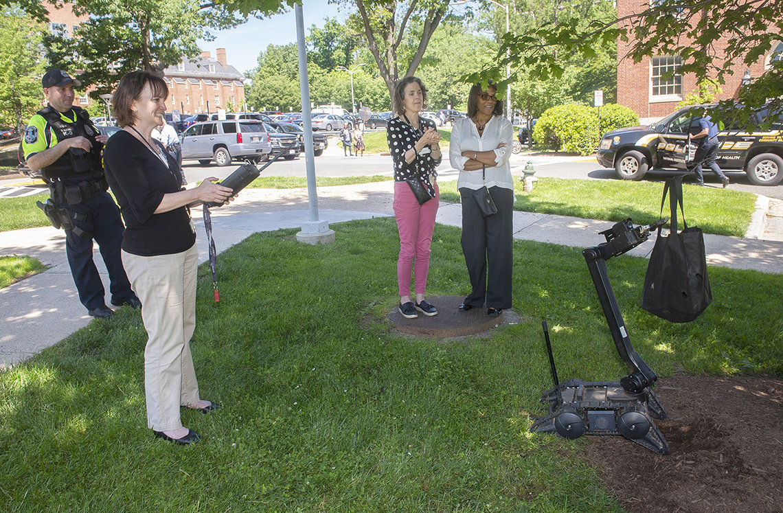 Clinical Center nurse guides robot remotely.