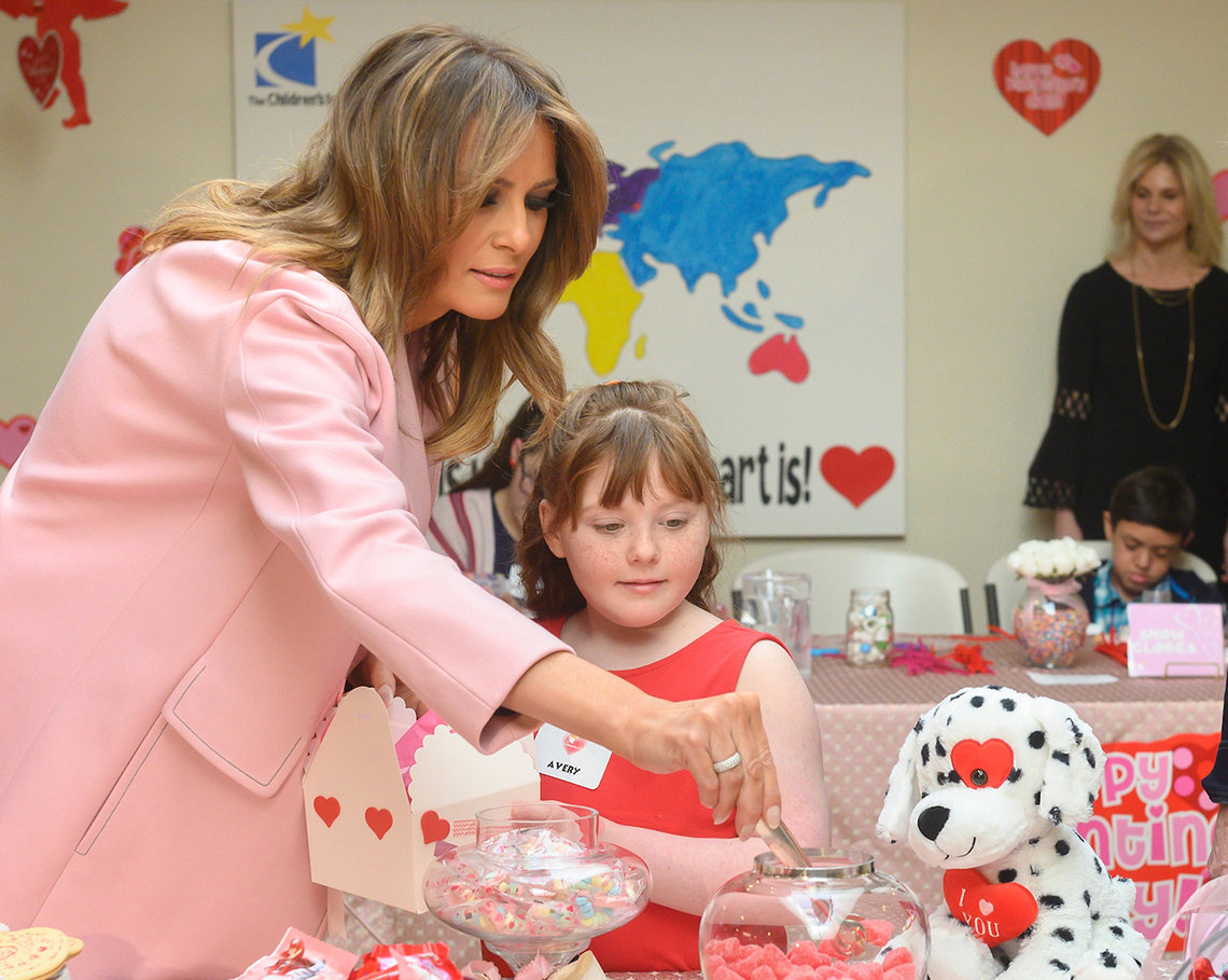 First Lady Trump selects candies from a jar