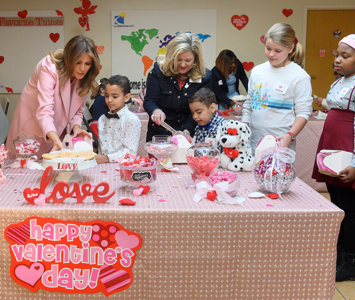 First Lady Trump and young inn resident chooses sugar cookies for a gift box