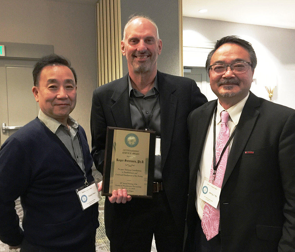Dr. Sorensen shows his award with Dr. Lin and Dr. He
