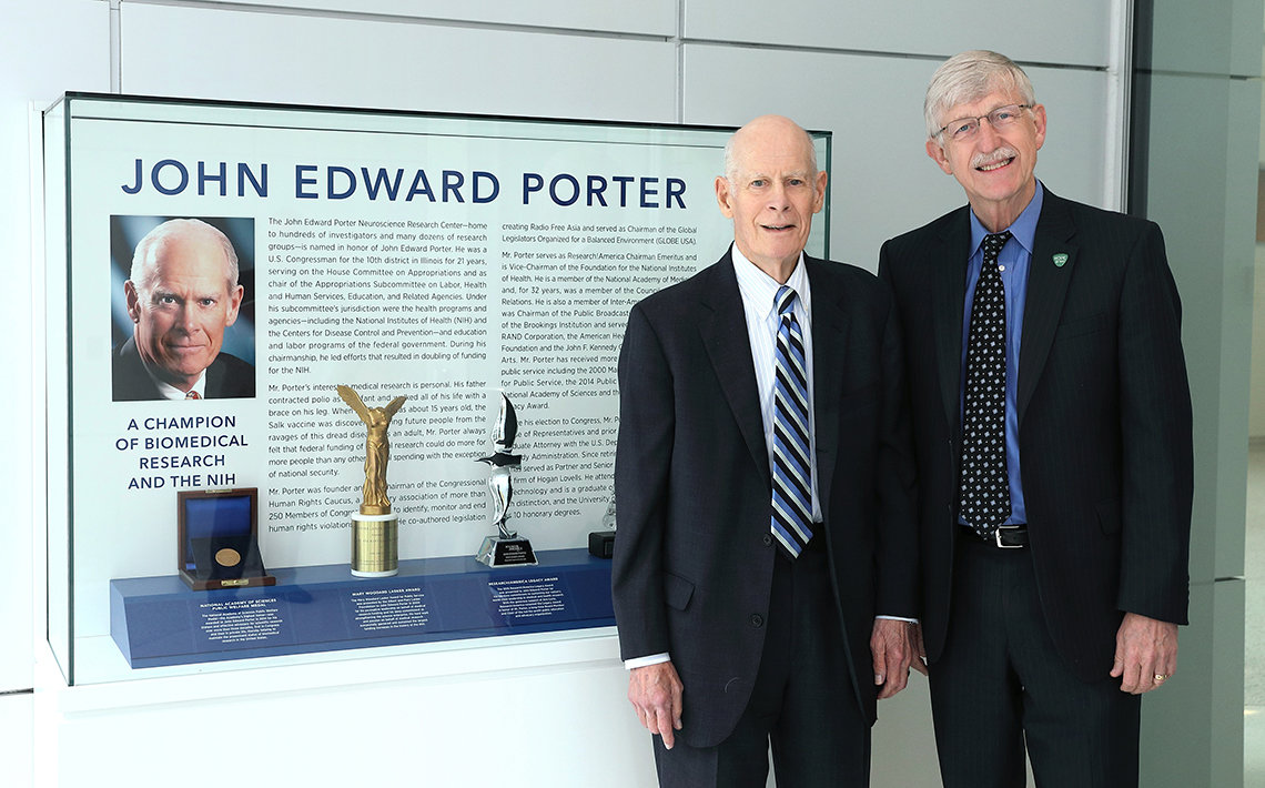Porter stands with Collins in front of new exhibit.