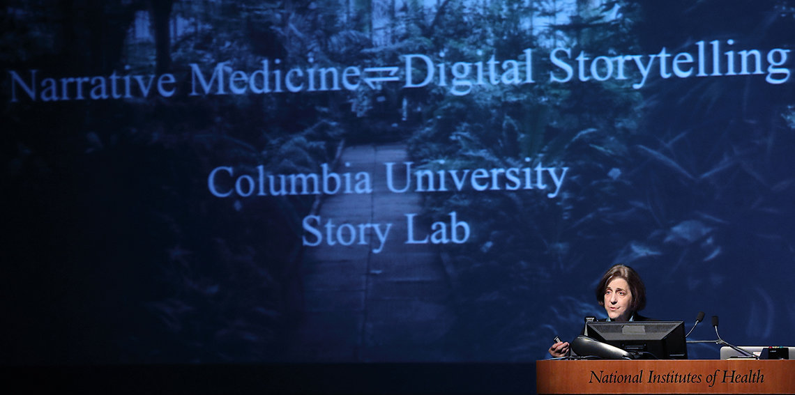 Charon speaks at podium in front of slide that reads narrative medicine equals digital storytelling, Columbia U Story Lab
