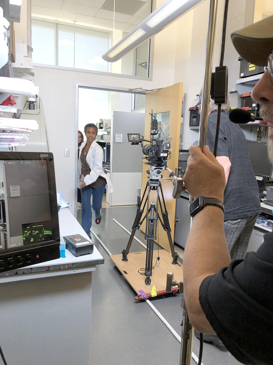 Female actor in lab coat running towards camera