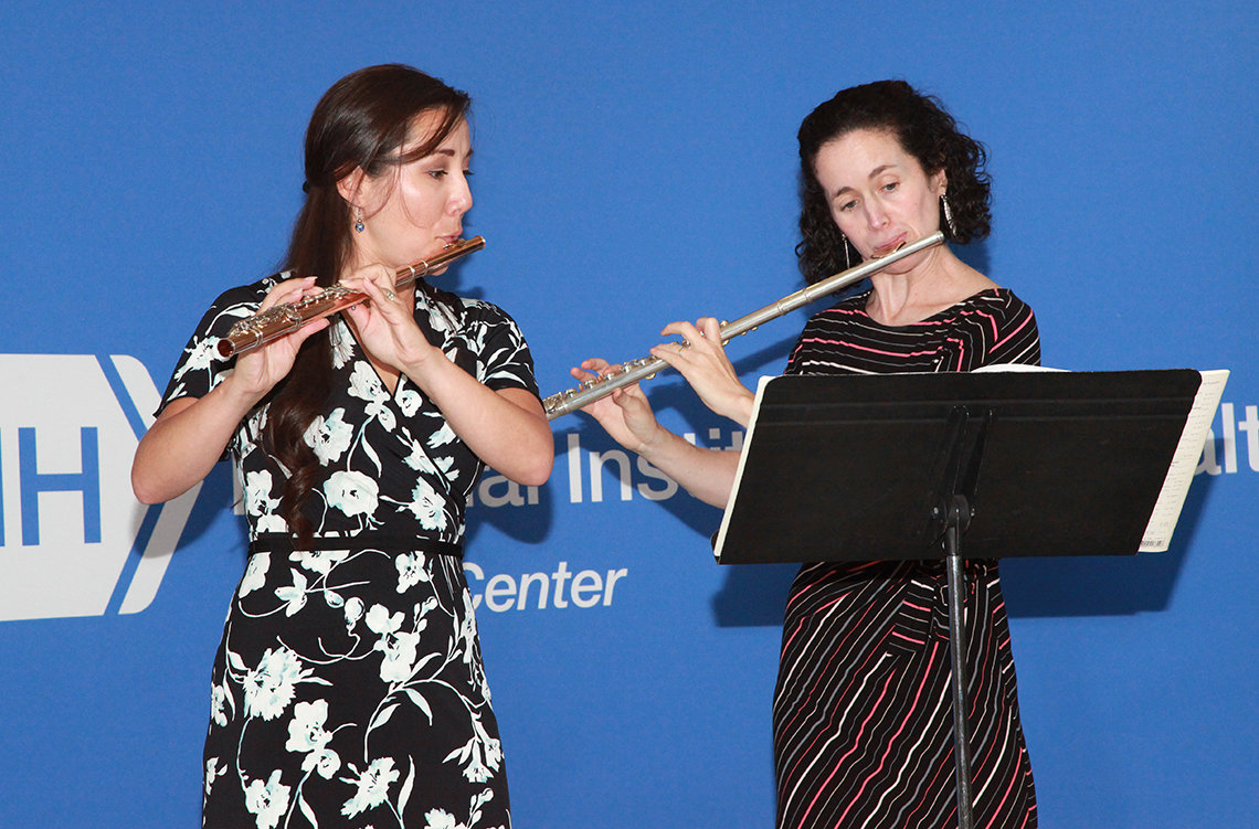 Frisof and Candelaria play flutes